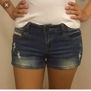 Medium wash denim shorts, lace on back pockets